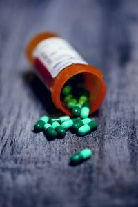 shallow focus photography of prescription bottle with capsules