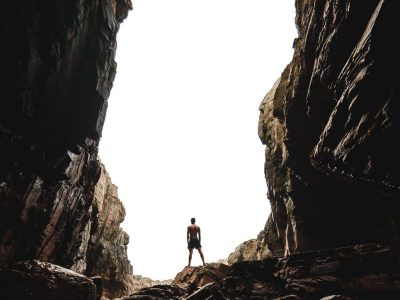 man standing on cave