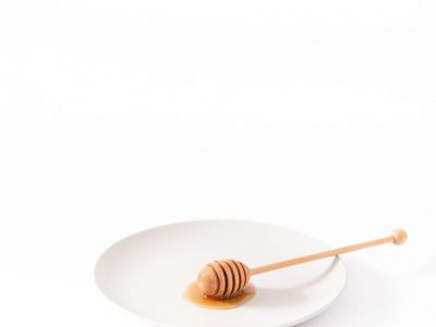 honey dipper on empty plate
